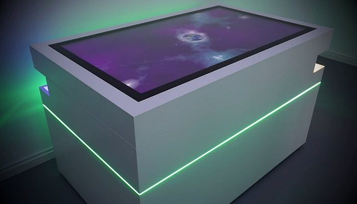 Multitouch table interactively illuminated with 660 LEDs