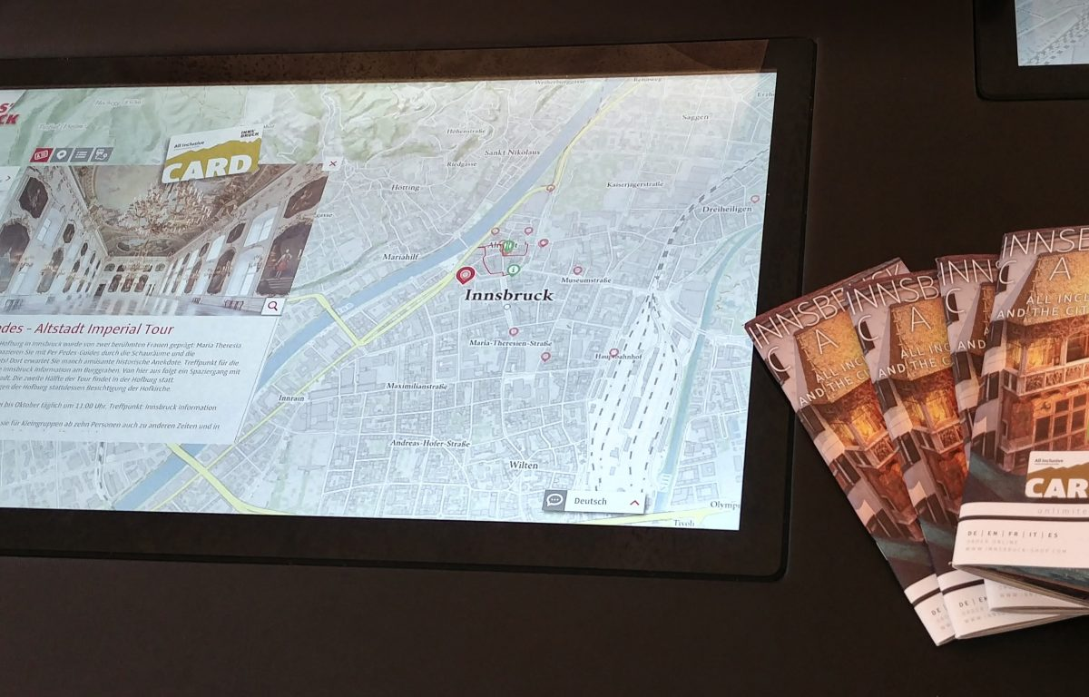 Multitouch table with interactive map and POIs in the region