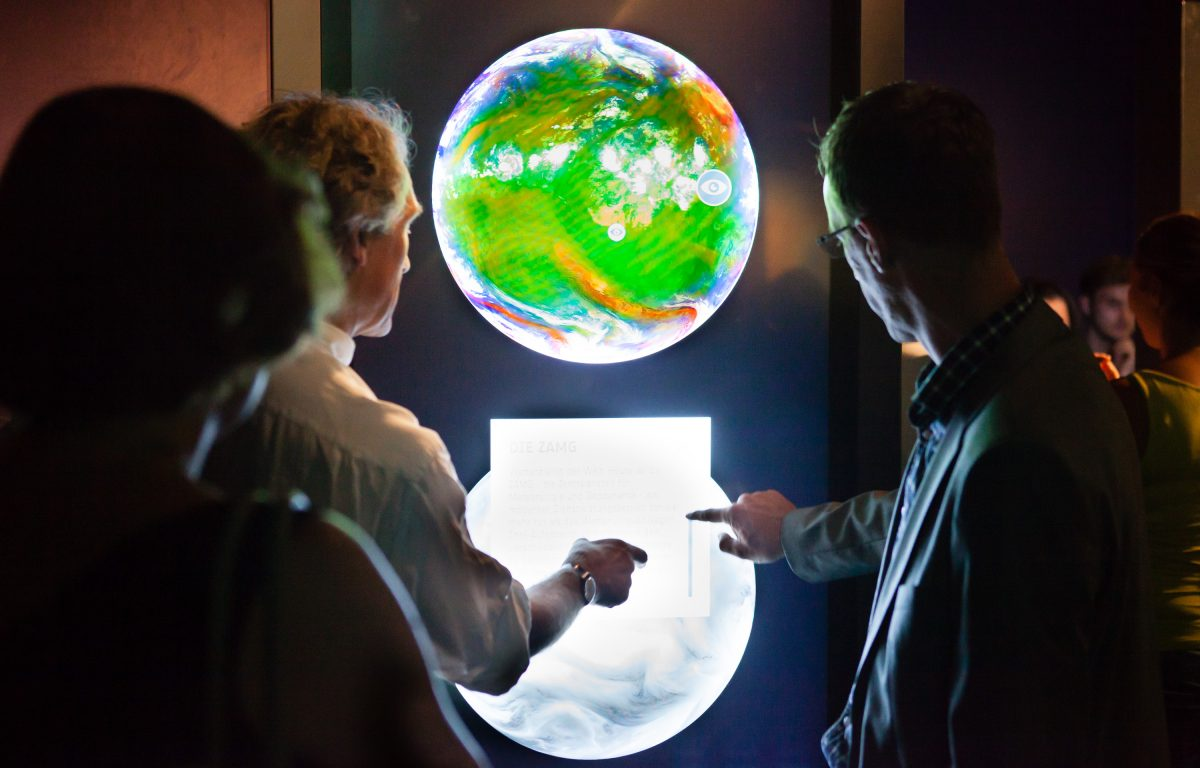 Exhibition about the ESA at the Ars Electronica Center - Visitors interact with interactive globe