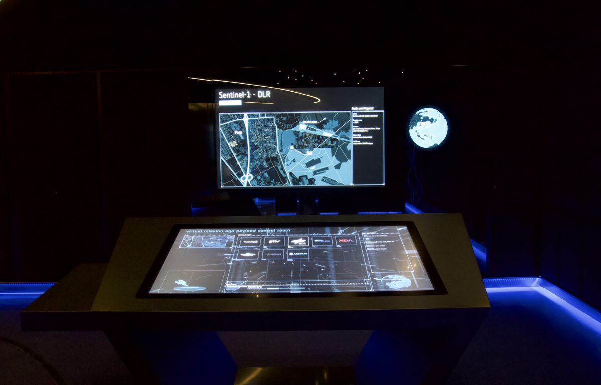 Multitouch table with presentation screen shows 3D satellite data