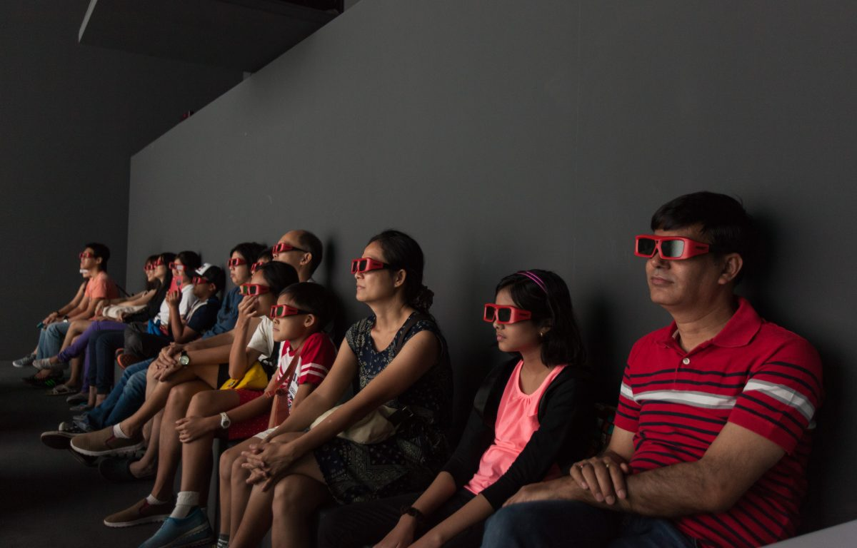 Visitors with 3D glasses in the Deep Space virtual reality environment