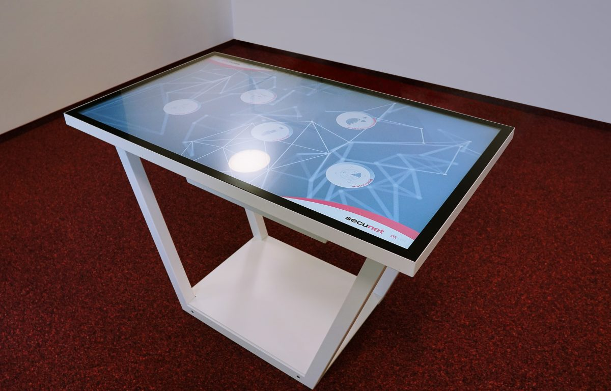 Showroom secunet - Multitouch table with design metal frame as central presentation tool