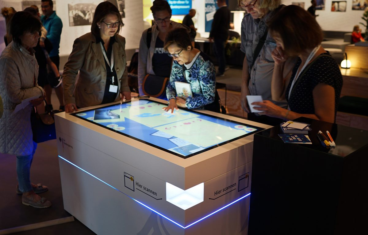 Visitors inform themselves and participate at the Federal Government's Open Day in Berlin