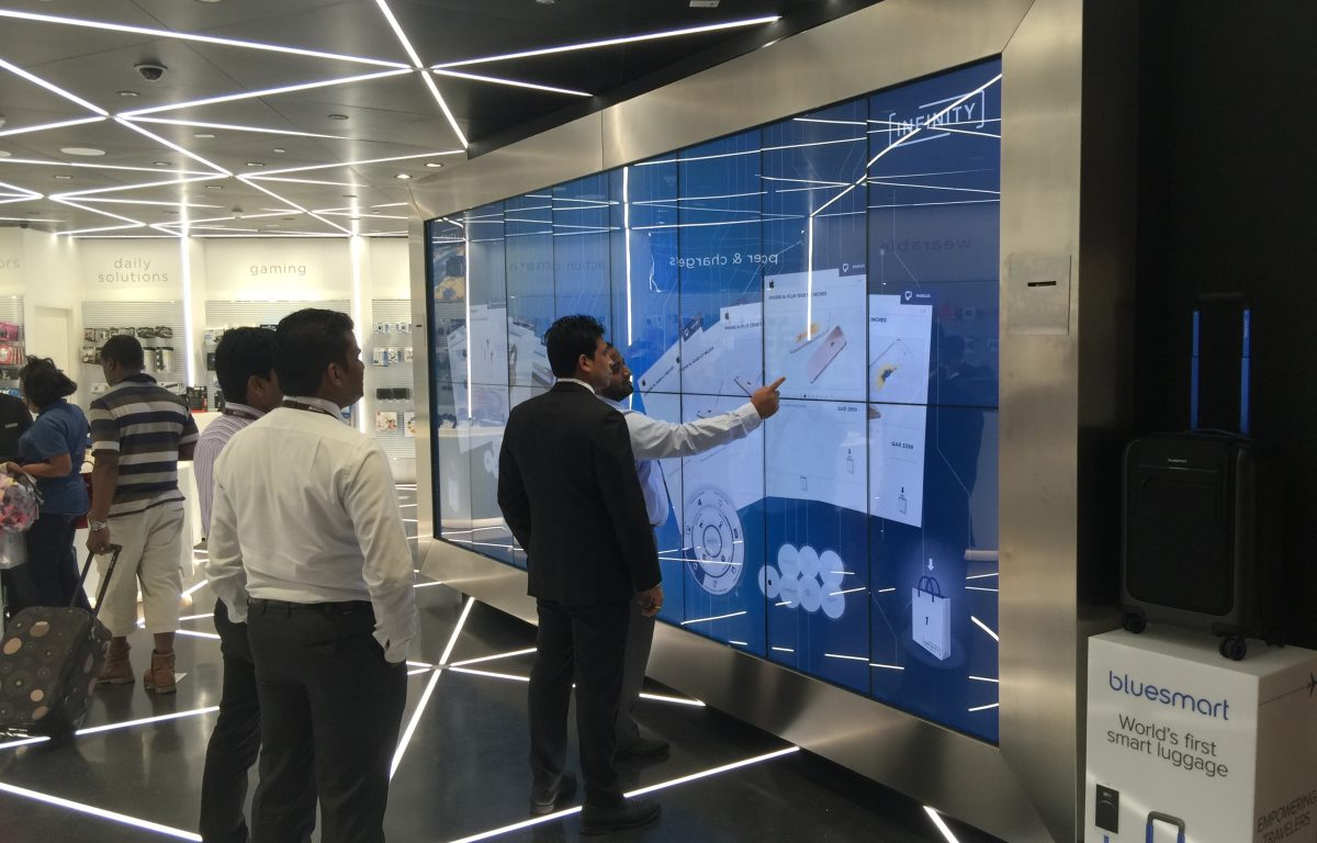 Customers in front of the interactive Shopping Wall