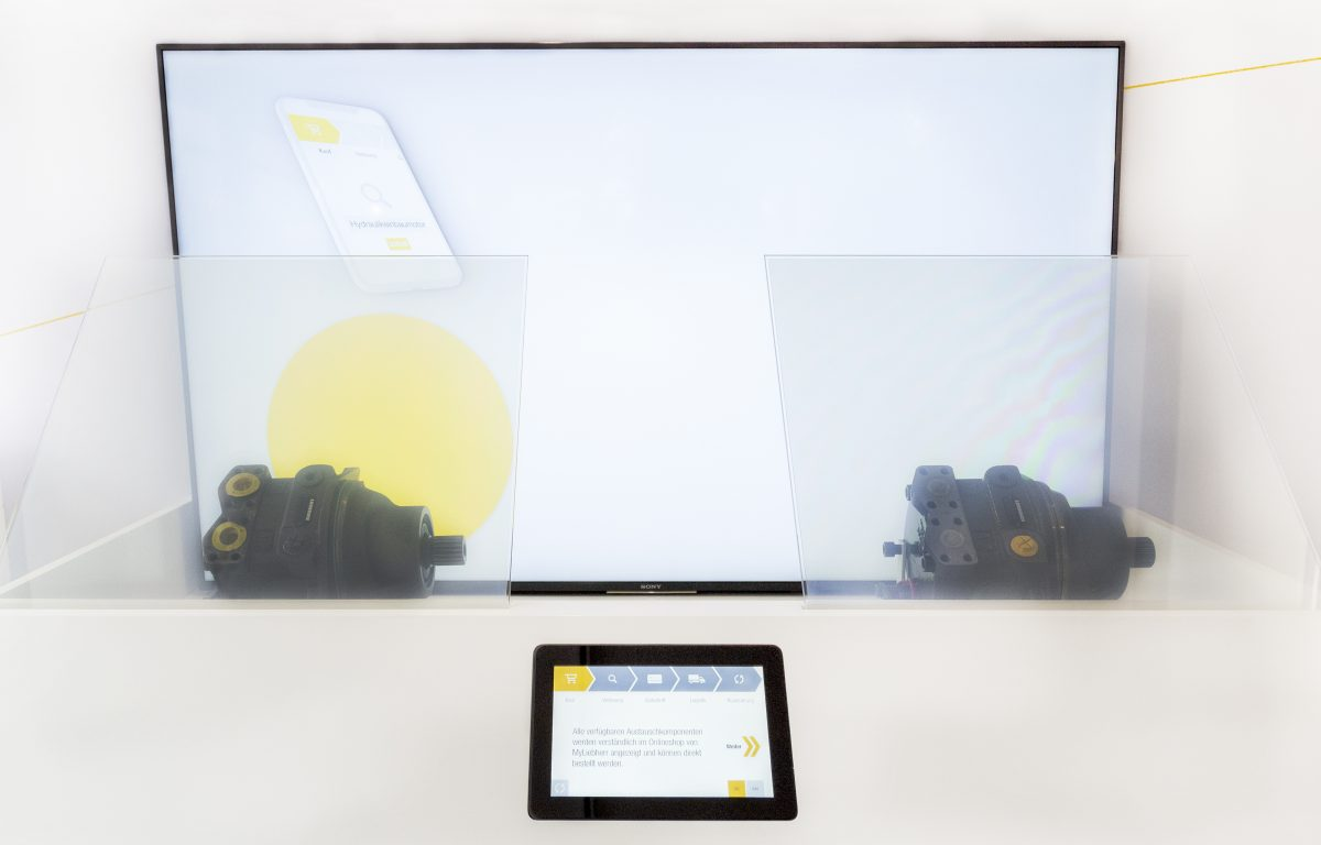 interactive showcase with touch panel and electrically switchable foil