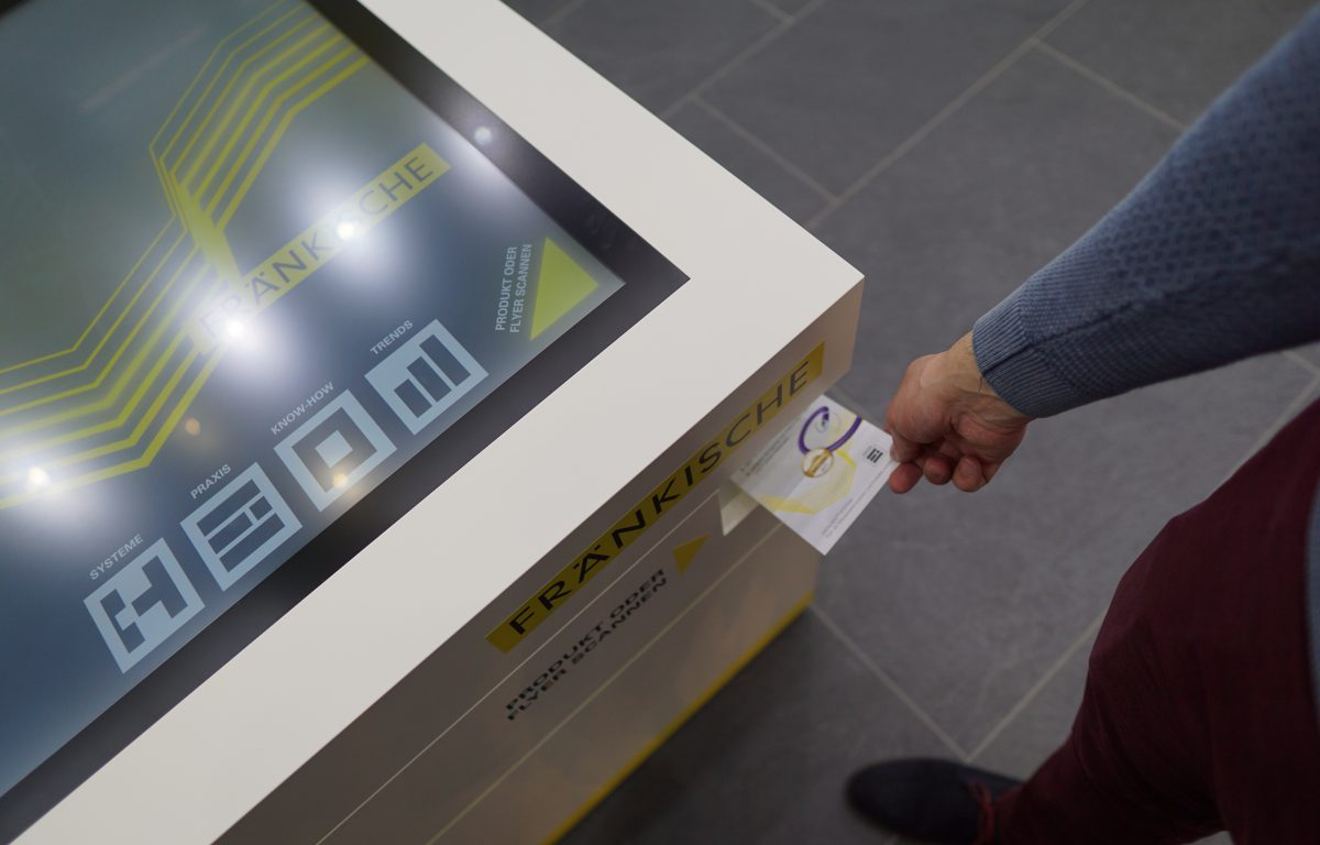 Optical object recognition scans flyers at the trade show booth